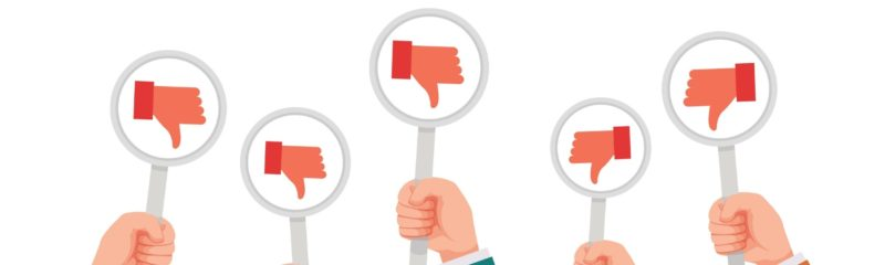 a series of thumbs down symbols coming from negative customer reviews