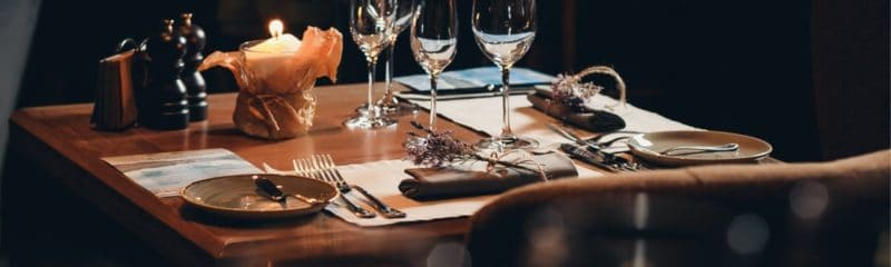 a picture of a restaurant table with tableware